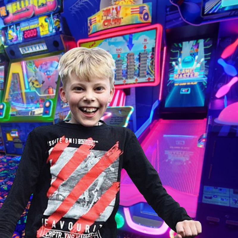 child ready for fun in arcade