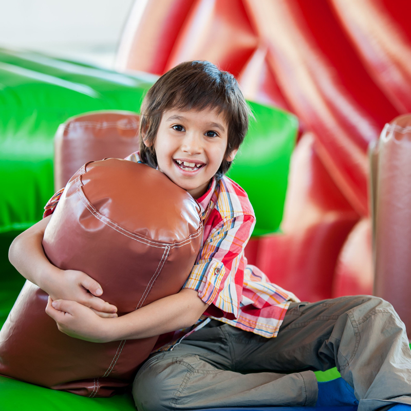 Child playing in bounce house